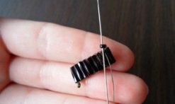needle up through the seed bead
